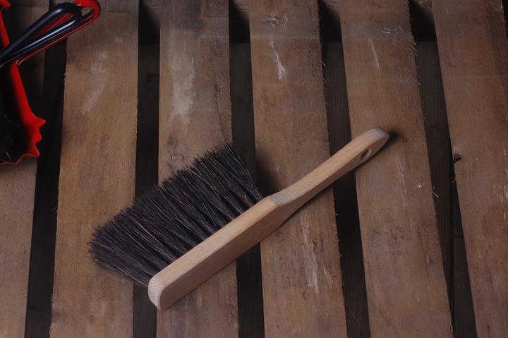 Stiff hand brush