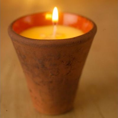 Small scented candle in terracotta pot