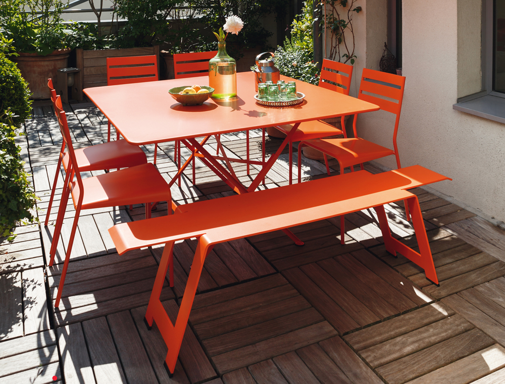 Cargo table with Facto chairs and Origami bench, all in Carrot