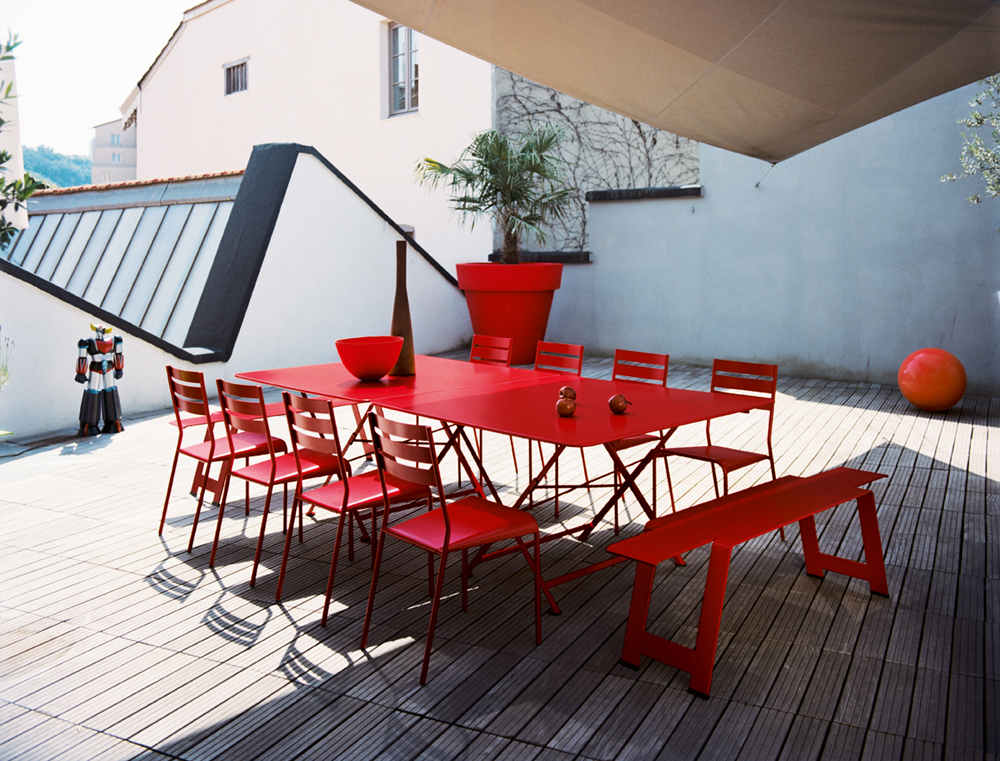 Cargo table (×2) with Facto chairs and Origami bench, all in Poppy
