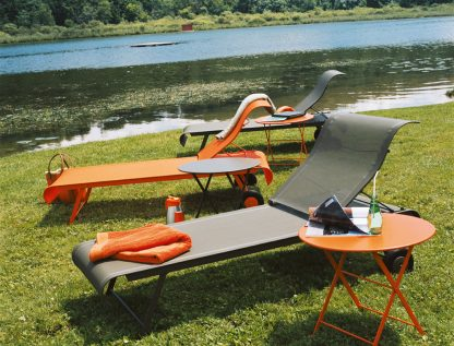 Dune sunloungers in Carrot (& Savanna - discontinued) with Tom Pouce side table in Carrot