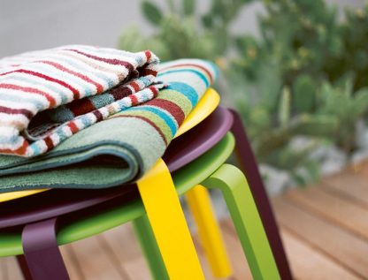 Alizé stacking side table in (top to bottom) Lemon (no longer available), Aubergine & Grass Green