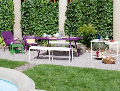 Luxembourg table, low armchairs and low armchair headrest in Aubergine, benches and drinks trolley in Cotton White, small low table/footrest in Grass Green