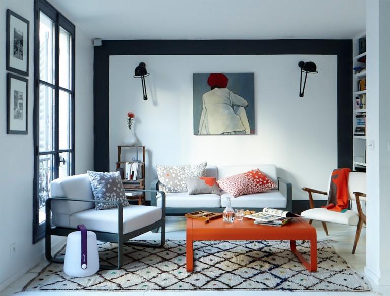 Bellevie low table in Carrot, Bellevie armchair and Bellevie sofa in Storm Grey, Balad lamp in Aubergine