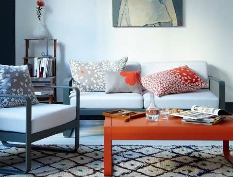 Bellevie low table in Carrot, Bellevie armchair and Bellevie sofa in Storm Grey