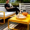 Bellevie sofa, Bellevie low table and Bellevie armchair, all in Honey