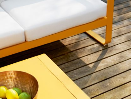 Bellevie sofa and Bellevie low table, both in Honey