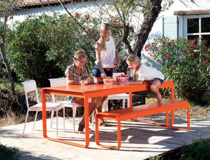 Bellevie table and, Bellevie bench in Carrot with Bellevie chairs in Cotton White