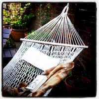 Rope hammock with wooden spreader bars