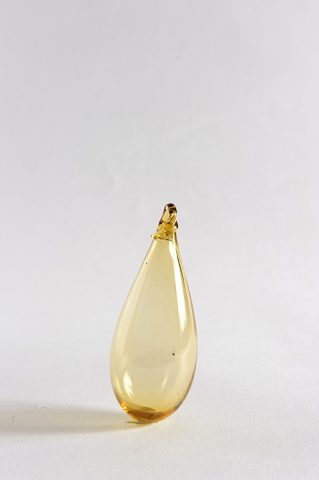Medium Syrian glass drop in amber
