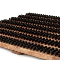 Wood and brush doormat in brown