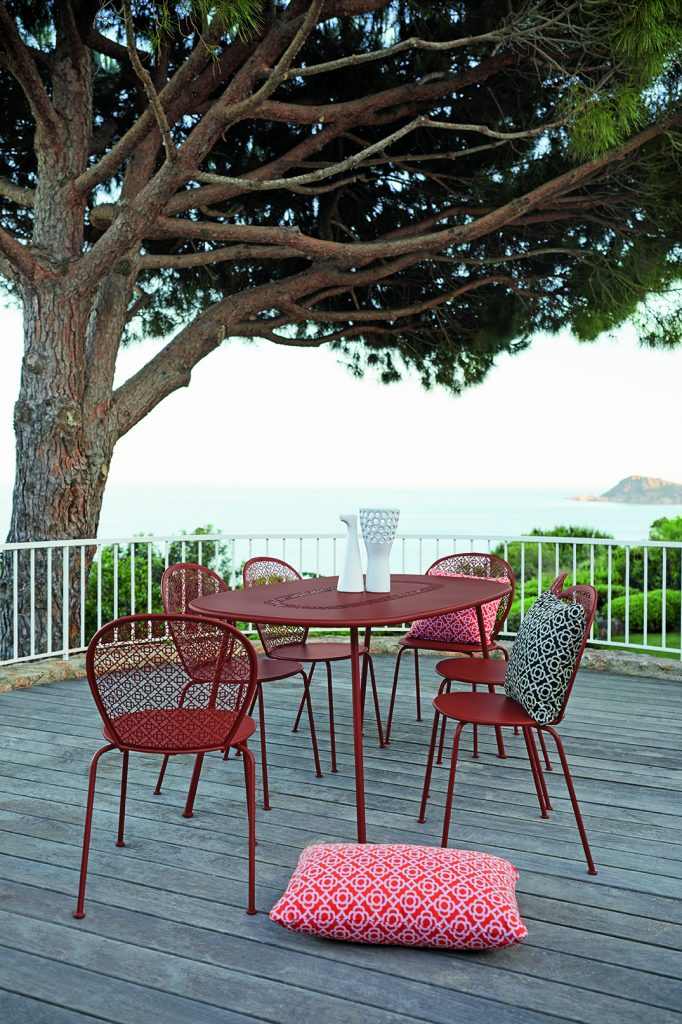 Lorette chairs and Lorette table in Red Ochre