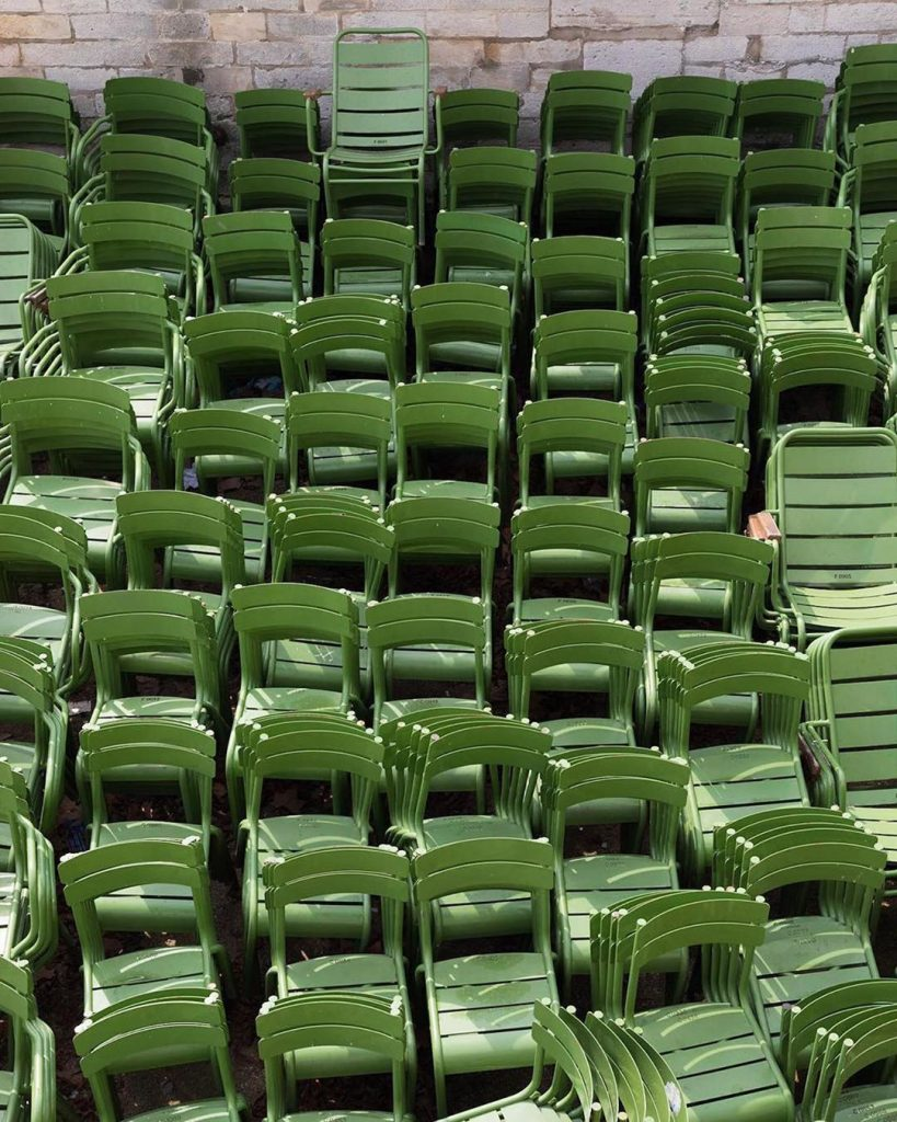 Luxembourg chairs, stacked at Le Jardin du Luxembourg, Paris. Photo by Fermob.