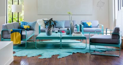 Bellevie armchairs, two seat sofas and low tables in Lagoon Blue with Flannel Grey cushions