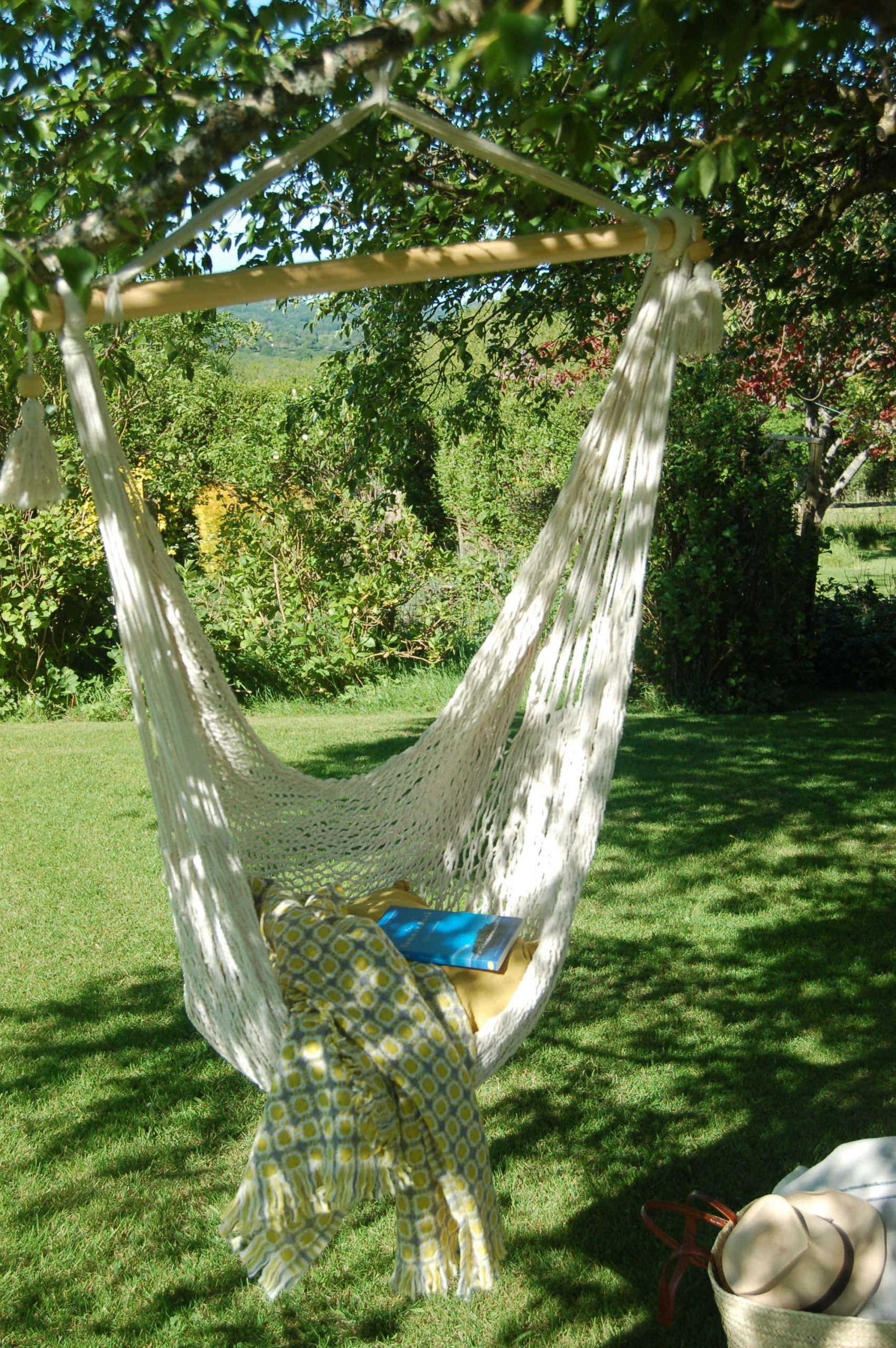 Woven cotton hanging chair available from le petit jardin